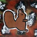 Veverica na jesenskem ozadju