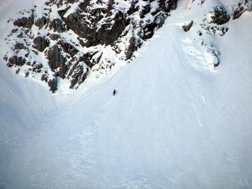 Alpinista na vstopu v Wisiakovo grapo v Planjavi.