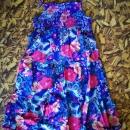 Zelo lepa lahka poletna oblekca st. 128 3€