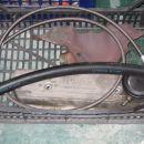 Opletena teflonska cev za dovod olja na turbino in cev za odvod olja v karter.