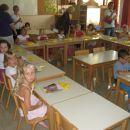 V razredu.